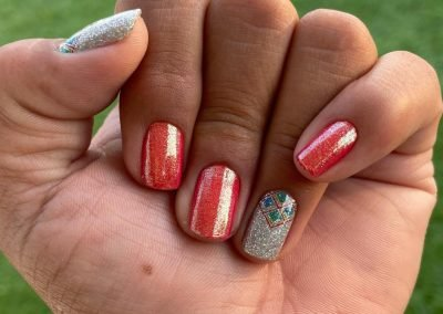 hand with multi-colored nails