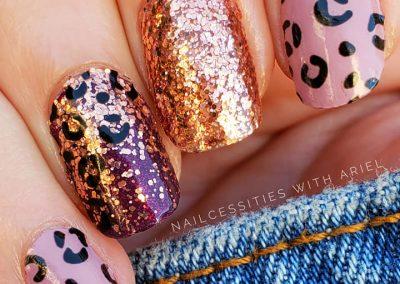 four fingers displaying designer nails